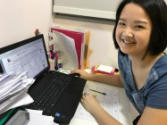 Tutor Yuet Ling preparing custom materials for PSLE English tuition classes